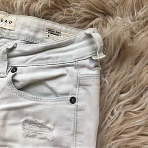White Distressed High Rise Skinny Jeans